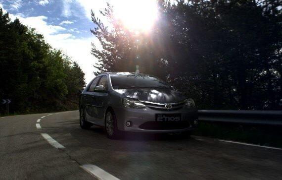 Toyoto Etios rental on road image